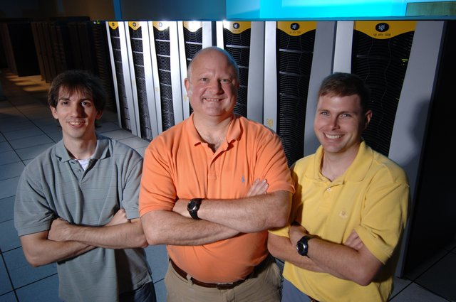 MCSR Graduate Assistant Sam Testa, and Electrical Engineering Professors Richard Gordon and Elliot Hutchcraft with Redwood. Testa first ran code on MCSR systesm as a student in Dr. Gordon's Parallel Programming class in 2004.
