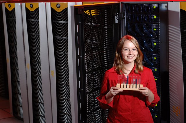 Julie Anderson poses in front of redwood, her MCSR supercomputer of choice. Julie received her Ph.D. in Chemistry from UM in 2007.